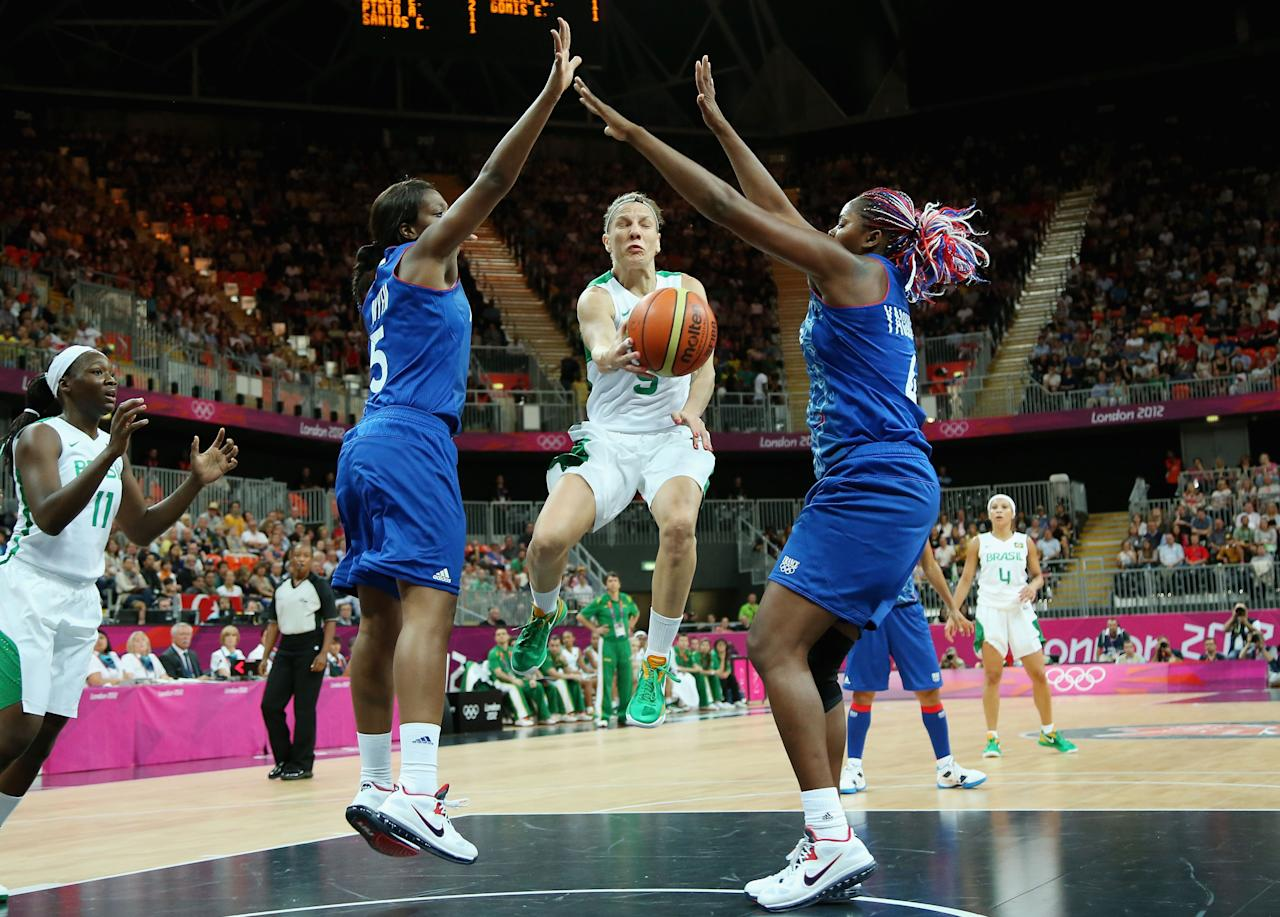 LONDON, ENGLAND - JULY 28:  Karla Costa #5 of Brazil looks to pass against Endene Miyem #5 of France and Isabelle Yacoubou #4 of France in the first half during Women's Basketball on Day 1 of the London 2012 Olympic Games at the Basketball Arena on July 28, 2012 in London, England.  (Photo by Christian Petersen/Getty Images)