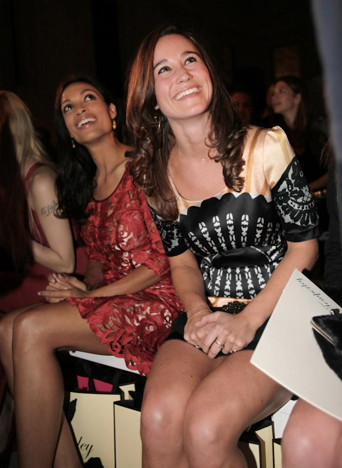 Members of the audience at a fashion show during The London Fashion Week, include Pippa Middleton, the sister of Britain's Kate, Duchess of Cambridge, right, with American actress Rosario Dawson, left, pictured during the Temperley London Spring/Summer 2012 fashion show held at the British Museum in London, Monday Sept. 19, 2011. (AP Photo / Katie Collins, PA) UNITED KINGDOM OUT - NO SALES - NO ARCHIVES