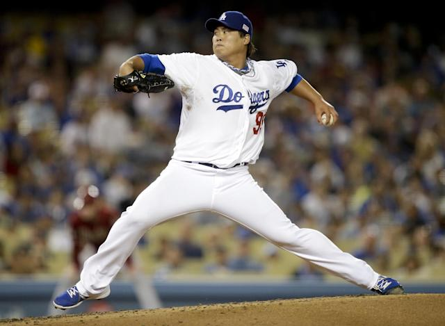Los Angeles Dodgers starting pitcher Hyun-jin Ryu, of South Korea, throws against the Arizona Diamondbacks during the third inning of a baseball game on Wednesday, Sept. 11, 2013, in Los Angeles. (AP Photo/Jae C. Hong)
