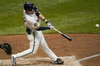 Milwaukee Brewers' Keston Hiura hits a three-run home run during the fourth inning of a baseball game against the St. Louis Cardinals Tuesday, Sept. 15, 2020, in Milwaukee. (AP Photo/Morry Gash)