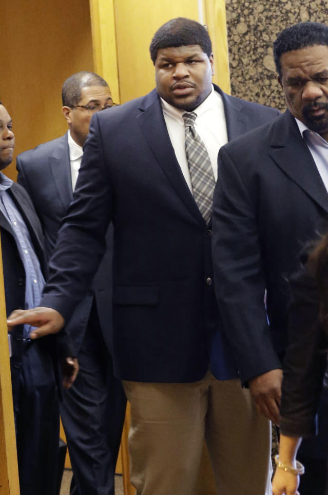 Former Dallas Cowboy Josh Brent walks out of court with his legal team at the end of the day of testimony in his trial for intoxication manslaughter, Wednesday, Jan. 15, 2014, in Dallas. Brent is accused of driving drunk at the time of a December 2012 crash that killed Cowboys practice squad player Jerry Brown. (AP Photo/LM Otero)