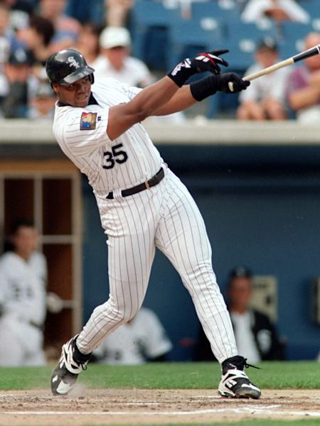 FILE - In this July 30, 1994 file photo, Chicago White Sox's Frank Thomas follows through on a home run against the Seattle Mariners in Chicago. Thomas is among three high-profile players on the baseball Hall of Fame ballot for the first time. The votes will be announced Wednesday, Jan. 8, 2014. (AP Photo/John Swart, File)