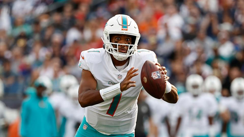 Miami Dolphins quarterback Tua Tagovailoa looks to throw against the New England Patriots during the first half of an NFL football game, Sunday, Sept. 12, 2021, in Foxborough, Mass. (AP Photo/Winslow Townson)