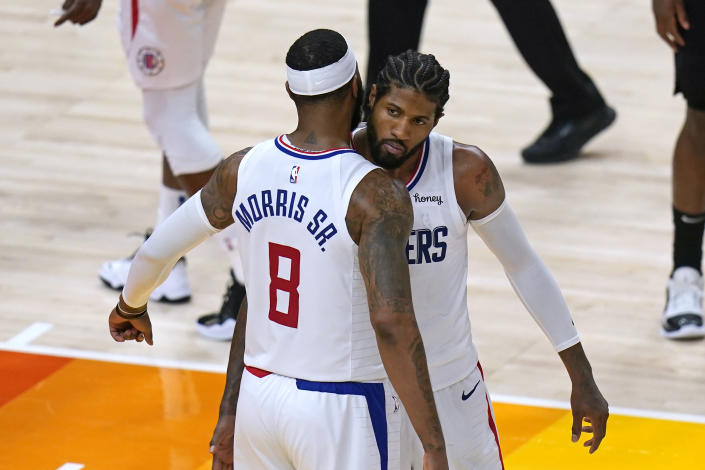 Los Angeles Clippers' Marcus Morris Sr. (8) and Paul George, rear, celebrate during the second half of Game 5 of the team's second-round NBA basketball playoff series against the Utah Jazz on Wednesday, June 16, 2021, in Salt Lake City. (AP Photo/Rick Bowmer)