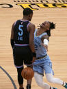 Memphis Grizzlies guard Ja Morant, right, loses the ball when after running into Sacramento Kings guard De'Aaron Fox during the first half of an NBA basketball game in Sacramento, Calif., Sunday, Feb. 14, 2021. (AP Photo/Rich Pedroncelli)