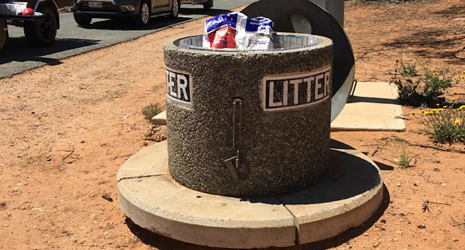 Rubbish bin at South Australia rest stop where eight puppies were found dumped.