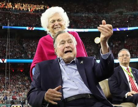 FILE PHOTO: Former U.S. President George H.W. Bush participates in the coin toss ahead of the start of Super Bowl LI between the New England Patriots and the Atlanta Falcons as former first lady Barbara Bush looks on in Houston , Texas, February 5, 2017. REUTERS/Adrees Latif