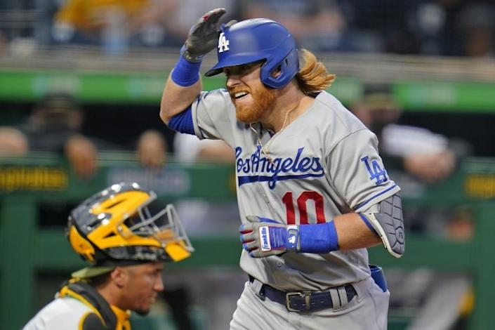Los Angeles Dodgers' Justin Turner (10) celebrates after crossing home plate after hitting a solo home run.