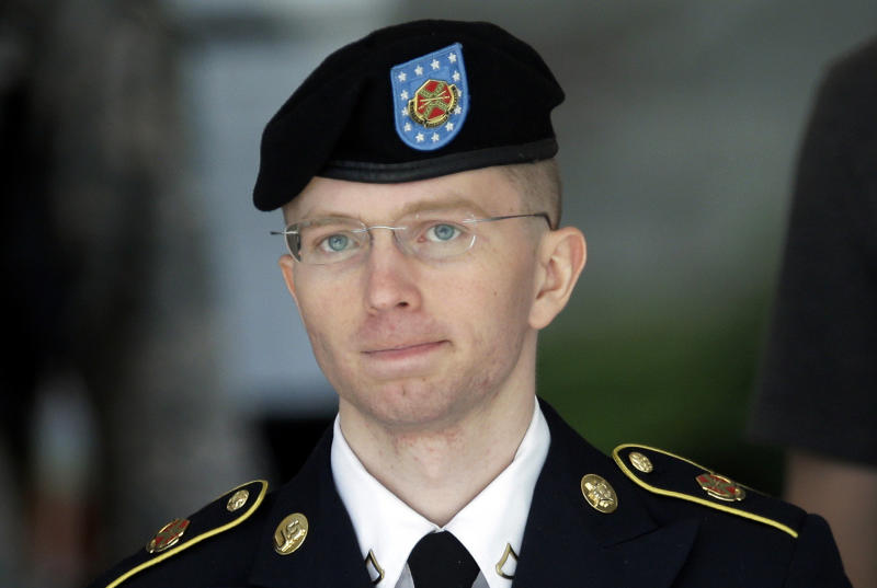 FILE - In this June 5, 2013, file photo Army Pvt. Chelsea Manning, then-Army Pfc. Bradley Manning, is escorted out of a courthouse in Fort Meade, Md., after the third day of his court martial. The U.S. government's aggressive prosecution of leaks and efforts to control information are having a chilling effect on journalists and government whistle-blowers, according to a report released Thursday on U.S. press freedoms under the Obama administration. Manning provided information to the anti-secrecy group Wikileaks. (AP Photo/Patrick Semansky, File)