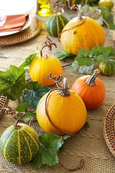 """<p>An autumnal centerpiece, including gourds and faux ivy garland, is an elegant way to dress up a table.<br></p><p><a class=""""link rapid-noclick-resp"""" href=""""https://go.redirectingat.com?id=74968X1596630&url=https%3A%2F%2Fwww.michaels.com%2F6ft-mini-grape-ivy-chain-garland-by-ashland%2F10308037.html&sref=https%3A%2F%2Fwww.goodhousekeeping.com%2Fholidays%2Fhalloween-ideas%2Fg33437890%2Fhalloween-table-decorations-centerpieces%2F"""" rel=""""nofollow noopener"""" target=""""_blank"""" data-ylk=""""slk:SHOP FAUX IVY GARLAND"""">SHOP FAUX IVY GARLAND</a></p>"""