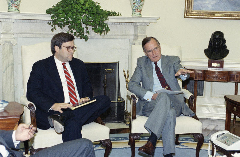 William Barr, left, is seen in 1992 with President George H.W. Bush when Barr was serving as U.S. attorney general. (ASSOCIATED PRESS)