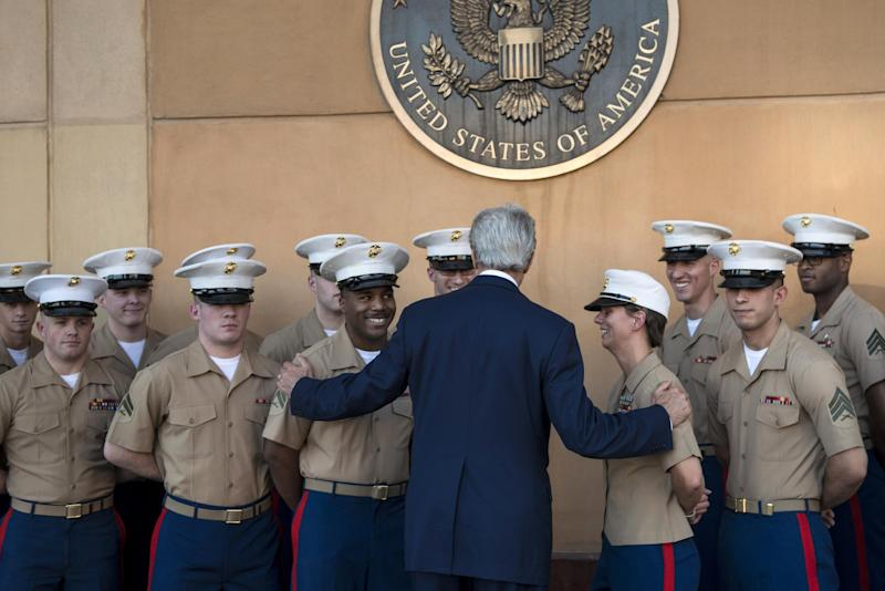 US Secretary of State John Kerry greets US marines as he arrives at the US embassy in the International Zone June 23, 2014 in the Iraqi capital Baghdad