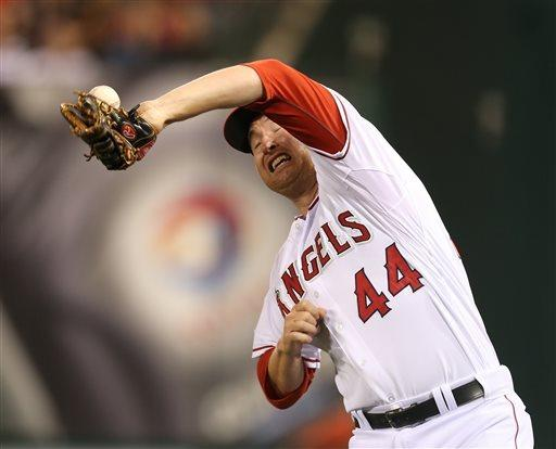 Los Angeles Angels first baseman Mark Trumbo can't hang on to a foul ball off Texas Rangers Adrian Beltre in the sixth in the first inning of a baseball game in Anaheim, Calif., on Tuesday, April  23, 2013. (AP Photo/Christine Cotter)