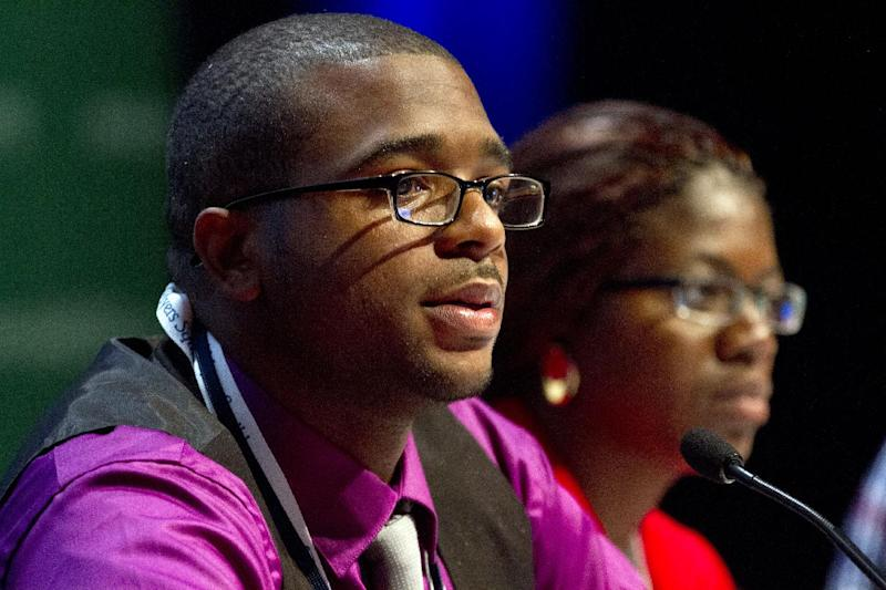 In this photo taken July 22, 2012, Lawrence Stallworth II, 20, of Cleveland, Ohio, left, who was diagnosed with HIV at age 17, speaks on a youth panel at the International AIDS Conference in Washington.  Stallworth learned he was infected with HIV at age 17, when he was a high-school senior, after a hospitalization. A black gay man, he's among one of the nation's highest-risk groups. He's now an Ohio AIDS activist who works to teach young people that they need to protect themselves, and how. Helena Nangombe of Namibia is at right.  (AP Photo/Jacquelyn Martin)(AP Photo/Jacquelyn Martin)