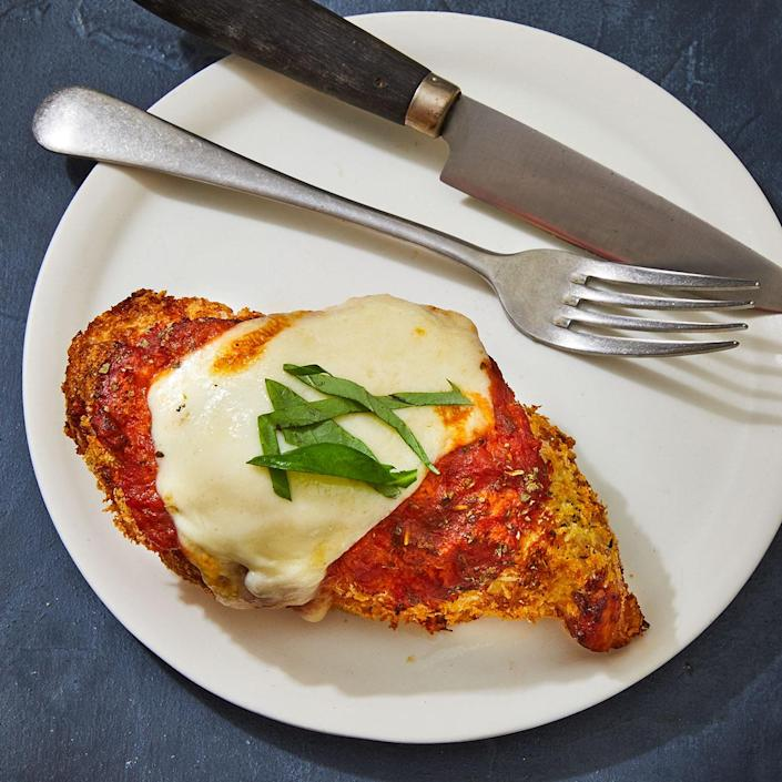 """<p>An air fryer is a great way to enjoy chicken Parmesan with much less oil. A 5- or 6-quart air fryer fits two chicken breasts perfectly to get that signature crispy crust. (A smaller air fryer will work too, but you may have to overlap the breasts a little.) <a href=""""https://www.eatingwell.com/recipe/7873463/air-fryer-chicken-parmesan/"""" rel=""""nofollow noopener"""" target=""""_blank"""" data-ylk=""""slk:View recipe"""" class=""""link rapid-noclick-resp""""> View recipe </a></p>"""