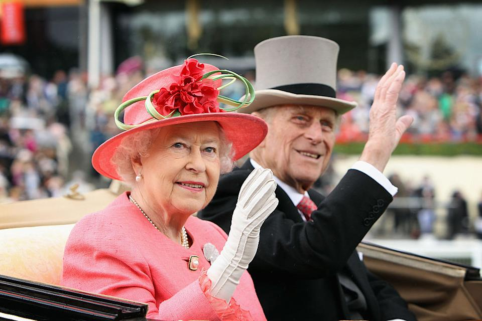 Queen Elizabeth ll and Prince Philip, Duke of Edinburgh wave from an open carriage on Ladies Day at Royal Ascot on June 16, 2011 in Ascot, England.