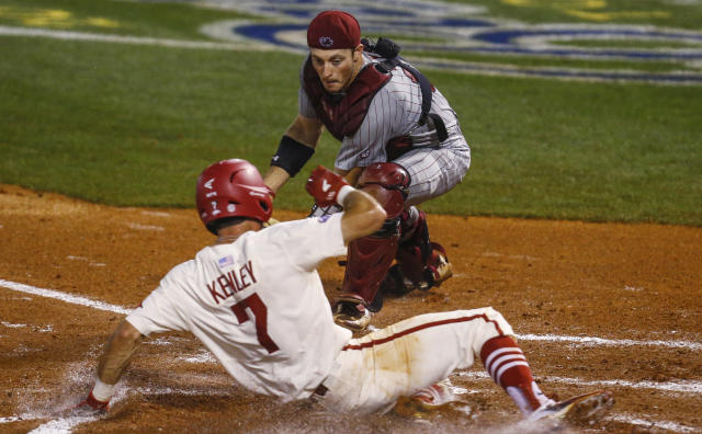 Arkansas' Jack Kenley (7) beats the tag from South Carolina catcher Hunter Taylor (38) as he scores during the second inning of a Southeastern Conference tournament NCAA college baseball game Wednesday, May 23, 2018, in Hoover, Ala. (AP Photo/Butch Dill)