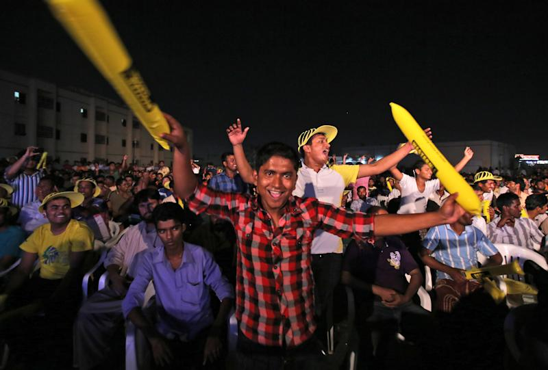 """Asian laborers enjoy dancing during the final night of the Champ of the Camp, season seven of a singing contest for laborers, dubbed """"Dubai Idol"""" at the Sonapur Labor camp in Dubai, United Arab Emirates Thursday. A rare break from the laborers' routine comes in the form of Champ of the Camp, which combines quiz show speed, """"American Idol'' showmanship and movie trivia knowledge into a traveling roadshow that visits different camps each week around Dubai. (AP Photo/Kamran Jebreili)"""