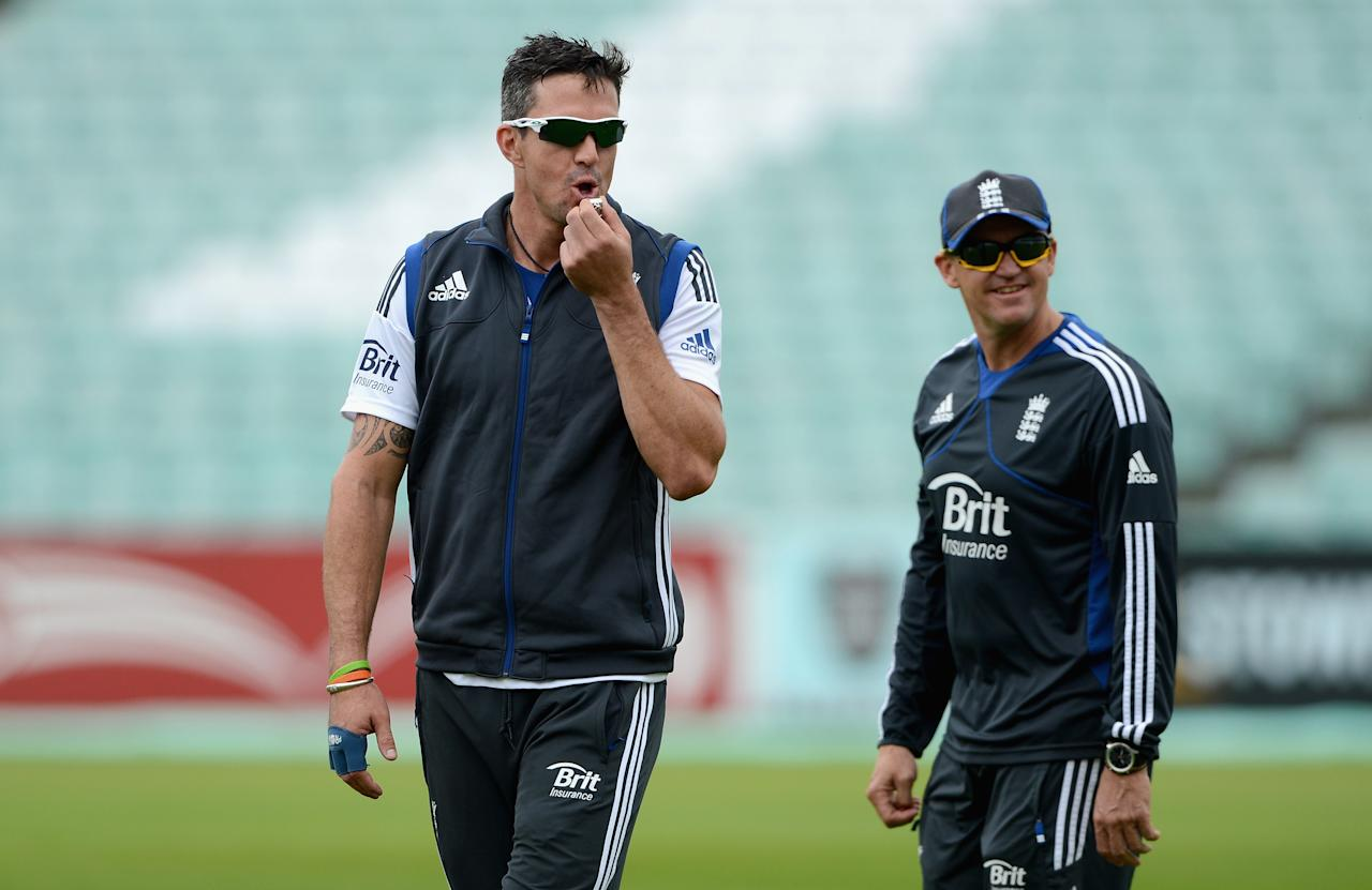 LONDON, ENGLAND - JULY 17:  Kevin Pietersen of England blows a whistle alongside coach Andy Flower during a nets session at The Kia Oval on July 17, 2012 in London, England.  (Photo by Gareth Copley/Getty Images)