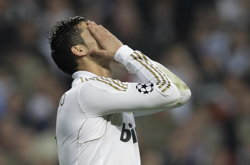Real Madrid's Cristiano Ronaldo from Portugal reacts after missing a penalty after extra time during a semifinal, second leg Champions League soccer match against Bayern Munich at the Santiago Bernabeu stadium in Madrid Wednesday April 25, 2012. (Bayern Munich won the match and go through to the final. AP Photo/Paul White)