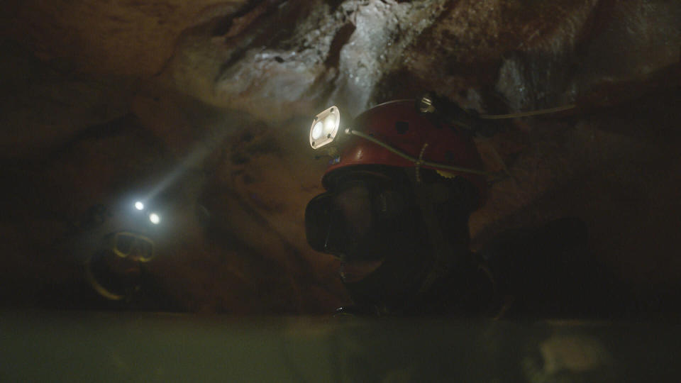 """This image released by National Geographic shows a scene from the documentary film """"The Rescue,"""" chronicling the 2018 rescue of 12 Thai boys and their soccer coach, trapped deep inside a flooded cave. (National Geographic via AP)"""
