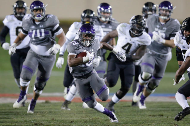 FILE - In this Nov. 11, 2017, file photo, Northwestern running back Jeremy Larkin (28) runs against Purdue during the second half of an NCAA college football game in Evanston, Ill. Larkin averaged 6 yards per carry as a redshirt freshman backing up four-time 1,000-yard rusher Justin Jackson. Larkin finished with 503 yards rushing and five touchdowns. (AP Photo/Nam Y. Huh, File)