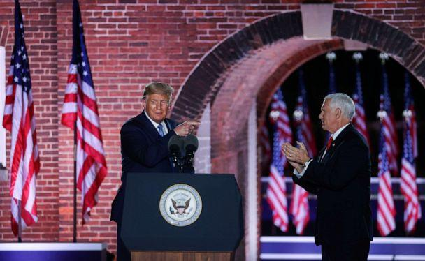 PHOTO: Vice President Mike Pence is joined onstage by President Donald Trump after delivering his acceptance speech during an event of the 2020 Republican National Convention held at Fort McHenry in Baltimore, Aug. 26, 2020. REUTERS/Jonathan Ernst (Jonathan Ernst/Reuters)