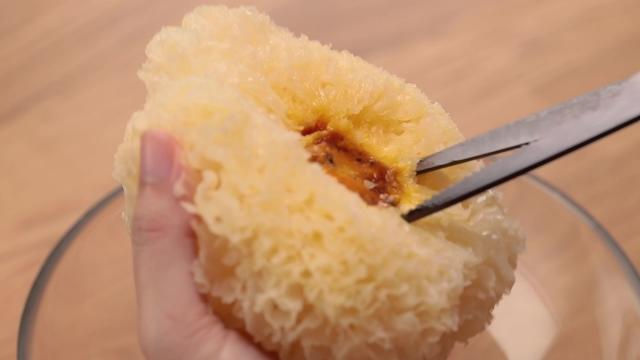 Removing the hard underside of white fungus with scissors