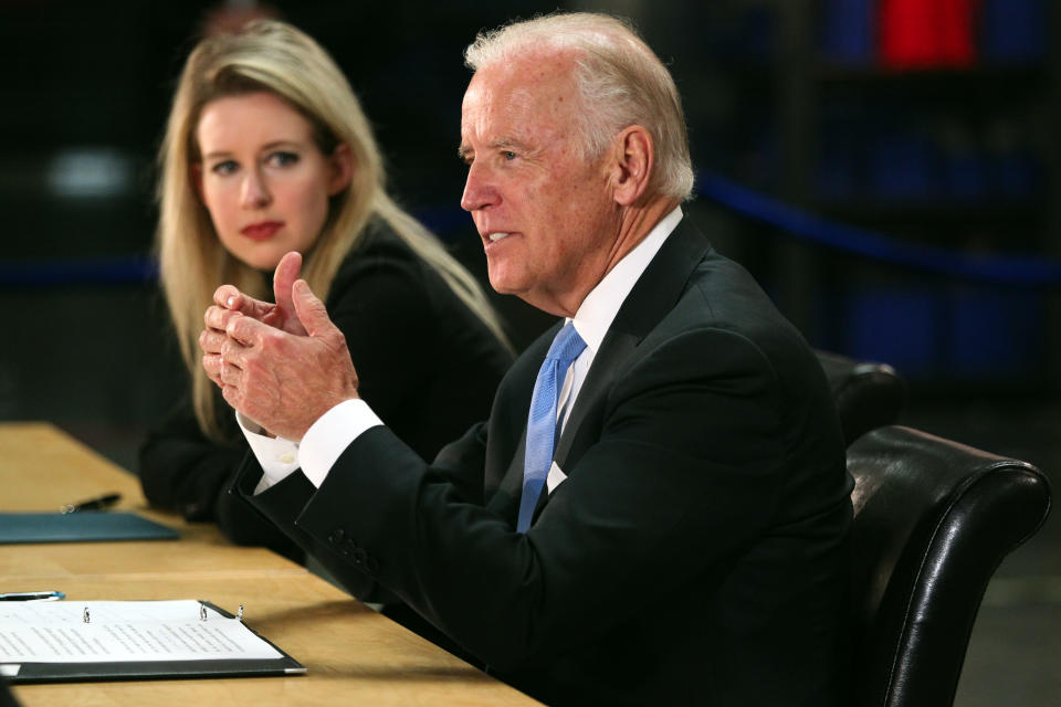 NEWARK, CALIFORNIA - JULY 23: Vice President Joe Biden, right, speaks as Elizabeth Holmes, founder and CEO of Theranos, left, listens during a visit to Theranos manufacturing  in Newark, Calif., on Thursday, July 23, 2015. Biden toured the facility and took part in a roundtable discussion on preventive health care, innovation and the role of the private sector in expanding access. Theranos makes a inexpensive, less painful finger-prick system to draw blood for tests. It can be used in a drug store and potentially at home. (Photo by Anda Chu/MediaNews Group/East Bay Times via Getty Images)