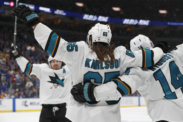 San Jose Sharks defenseman Erik Karlsson (65), of Sweden, celebrates with Gustav Nyquist (14), of Sweden, and Logan Couture, left, after Karlsson scored the winning goal against the St. Louis Blues during overtime in Game 3 of the NHL hockey Stanley Cup Western Conference final series Wednesday, May 15, 2019, in St. Louis. The Sharks won 5-4 to take a 2-1 lead in the series. (AP Photo/Jeff Roberson)