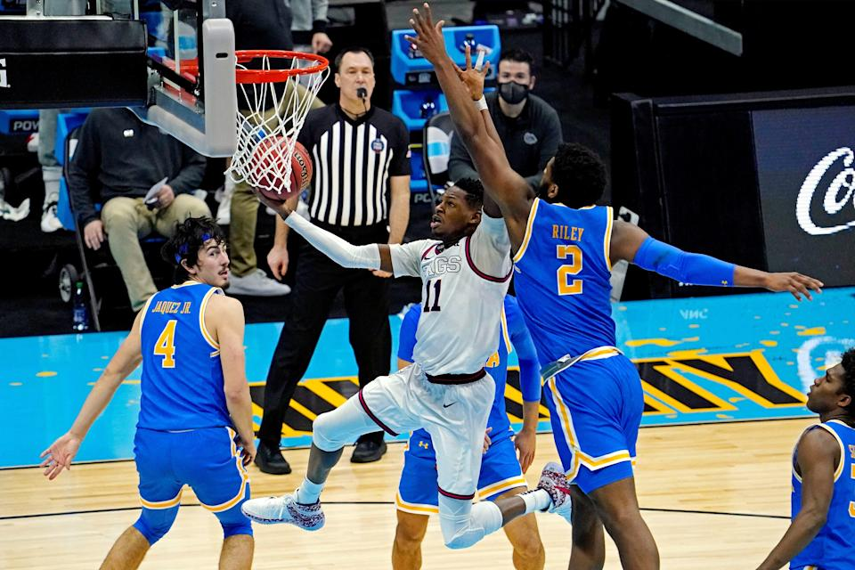Gonzaga guard Joel Ayayi (11) takes the ball to the rim against UCLA forward Cody Riley (2) during their national semifinal game.