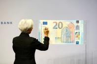 FILE PHOTO: European Central Bank (ECB) President Lagarde gives a signature for newly printed euro banknotes in Frankfurt