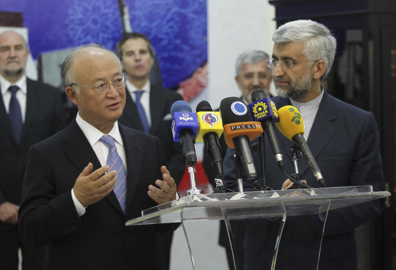 International Atomic Energy Agency (IAEA) chief Yukiya Amano, left, talks with reporters during a news briefing at the conclusion of his meeting with Iran's top nuclear negotiator, Saeed Jalili, right, in Tehran, Iran, Monday, 21, 2012. The head of the U.N. nuclear agency arrived Monday in Tehran on a key mission that could lead to the resumption of probes by the watchdog on whether Iran has secretly worked on an atomic weapon. It would also strength the Islamic Republic's negotiating hand in crucial nuclear talks with six world powers later this week in Baghdad. (AP Photo/IRNA,Adel Pazzyar)