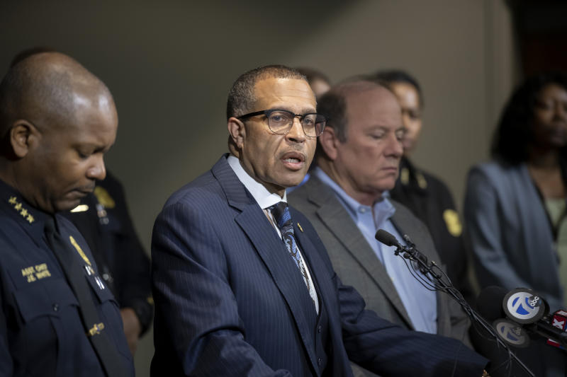 Detroit Police Chief James Craig, second left, speaks to the media at Detroit Public Safety Headquarters, Thursday, November 21, 2019, about two officers who were shot Wednesday evening while responding to a home invasion on Detroit's west side. Officer Rasheen McLain was killed during the incident and another officer was wounded.  (David Guralnick/Detroit News via AP)