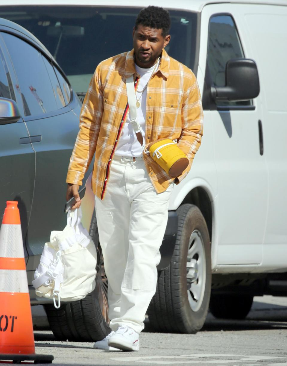 <p>Usher brightens up the day in Los Angeles on Friday.</p>
