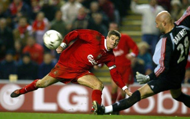 Fabien Barthez, playing for Marseille, saves from Liverpool's Steven Gerrard