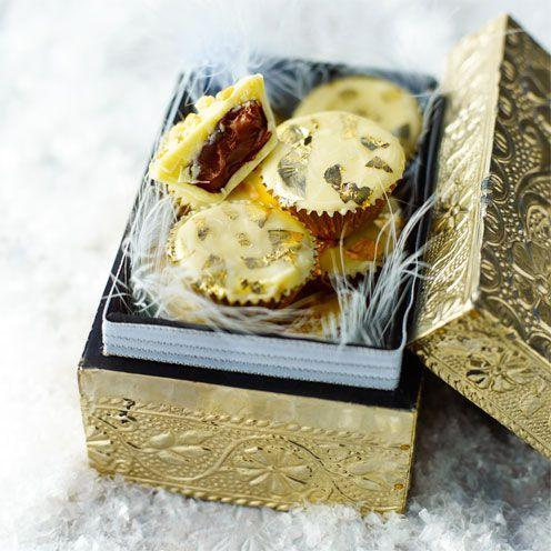 """<p>A crisp exterior and luscious soft interior make these the ideal Christmas chocolate. They're so easy to make, and they keep well, too!</p><p><strong>Recipe: <a href=""""https://www.goodhousekeeping.com/uk/food/recipes/white-chocolate-and-hazelnut-cups"""" rel=""""nofollow noopener"""" target=""""_blank"""" data-ylk=""""slk:White chocolate and hazelnut cups"""" class=""""link rapid-noclick-resp"""">White chocolate and hazelnut cups</a></strong><br><br><br></p>"""