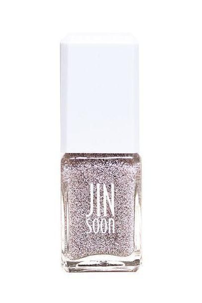 """<p><strong>Jin Soon Nail Polish in OHKO</strong></p><p>jinsoon.com</p><p><strong>$18.00</strong></p><p><a href=""""https://go.redirectingat.com?id=74968X1596630&url=https%3A%2F%2Fjinsoon.com%2Fohko%2F&sref=https%3A%2F%2Fwww.marieclaire.com%2Fbeauty%2Fg3965%2Ffall-nail-colors%2F"""" rel=""""nofollow noopener"""" target=""""_blank"""" data-ylk=""""slk:SHOP IT"""" class=""""link rapid-noclick-resp"""">SHOP IT</a></p><p>This gritty topper is the ideal swap out for summer's chunky glitter. The formula's taupe, beige, and white speckles can be worn over a reserved nude for an elevated twist, or all on their own to add elevated texture to a bare nail. </p>"""