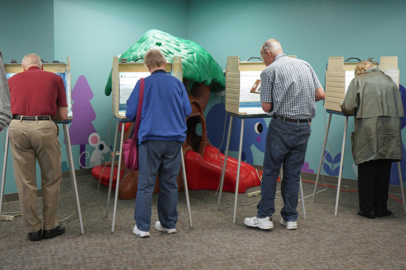 Voters fill in their ballots at a polling station in Omaha, Neb., Tuesday, May 15, 2018. Omaha-area voters are set to pick a Democratic nominee Tuesday who will challenge U.S. Rep. Don Bacon, R-Neb., after the congressman claimed the seat from Democrats two years ago. (AP Photo/Nati Harnik)
