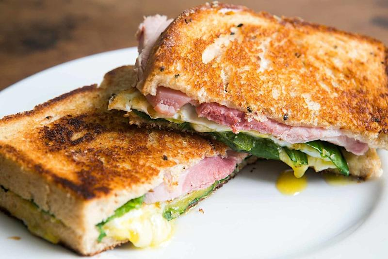 "<strong>Get the <a href=""https://www.simplyrecipes.com/recipes/greens_eggs_and_ham_grilled_cheese_sandwich/"" target=""_blank"">Greens, Eggs and Ham Grilled Cheese Sandwich</a> from Simply Recipes.</strong>"