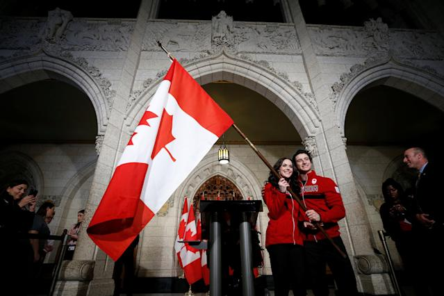 Ice dancers Tessa Virtue and Scott Moir pose with a Canadian flag after being named Canada's flag-bearers for the opening ceremony of the 2018 Pyeongchang Winter Olympic Games during an event on Parliament Hill in Ottawa, Ontario, Canada, January 16, 2018. REUTERS/Chris Wattie