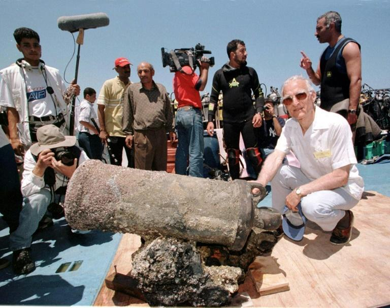 Louis-Napoleon Bonaparte-Wyse (R), a descendant of Napoleon, poses with a cannon retrieved from one of the general's sunken ships in Alexandria