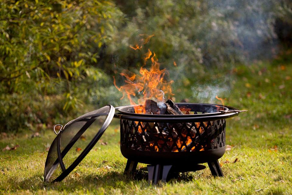 """<p>As summer begins to wane, chilly evenings don't have to drive you indoors. You still can enjoy your garden's beauty—but by firelight! Fire pits come in all shapes and sizes, and there's one for every budget. While most burn wood, many also are powered by propane or natural gas. Some are portable enough to take with you on <a href=""""https://www.countryliving.com/life/travel/g20901668/car-camping/"""" rel=""""nofollow noopener"""" target=""""_blank"""" data-ylk=""""slk:camping trips"""" class=""""link rapid-noclick-resp"""">camping trips</a> or <a href=""""https://www.countryliving.com/diy-crafts/g21095894/tailgate-games/"""" rel=""""nofollow noopener"""" target=""""_blank"""" data-ylk=""""slk:tailgating parties"""" class=""""link rapid-noclick-resp"""">tailgating parties</a>. So, throw on a sweater and get ready to enjoy <a href=""""https://www.countryliving.com/gardening/garden-ideas/g2314/backyard-ideas/"""" rel=""""nofollow noopener"""" target=""""_blank"""" data-ylk=""""slk:your backyard"""" class=""""link rapid-noclick-resp"""">your backyard</a> with these best outdoor fire pits.</p><p>For more ways to cozy up your outdoor space, check out our <a href=""""https://www.countryliving.com/shopping/g36502217/best-patio-heaters/"""" rel=""""nofollow noopener"""" target=""""_blank"""" data-ylk=""""slk:patio heaters"""" class=""""link rapid-noclick-resp"""">patio heaters</a> and <a href=""""https://www.countryliving.com/gardening/news/g3404/backyard-string-lights/"""" rel=""""nofollow noopener"""" target=""""_blank"""" data-ylk=""""slk:backyard string lights"""" class=""""link rapid-noclick-resp"""">backyard string lights</a>.</p>"""