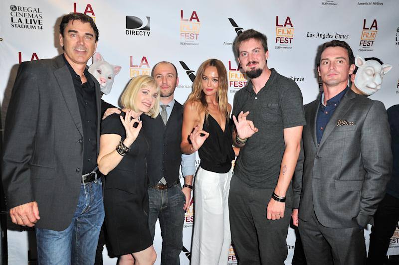 "Actors Rob Moran, Barbara Crampton, writer Simon Barrett, actress Sharni Vinson, director Adam Wingard and actor Nicholas Tucci arrive at the ""You're Next"" premiere during the 2013 Los Angeles Film Festival at American Airlines Theater on June 16, 2013 in Los Angeles, California. (Photo by Jerod Harris/WireImage)"