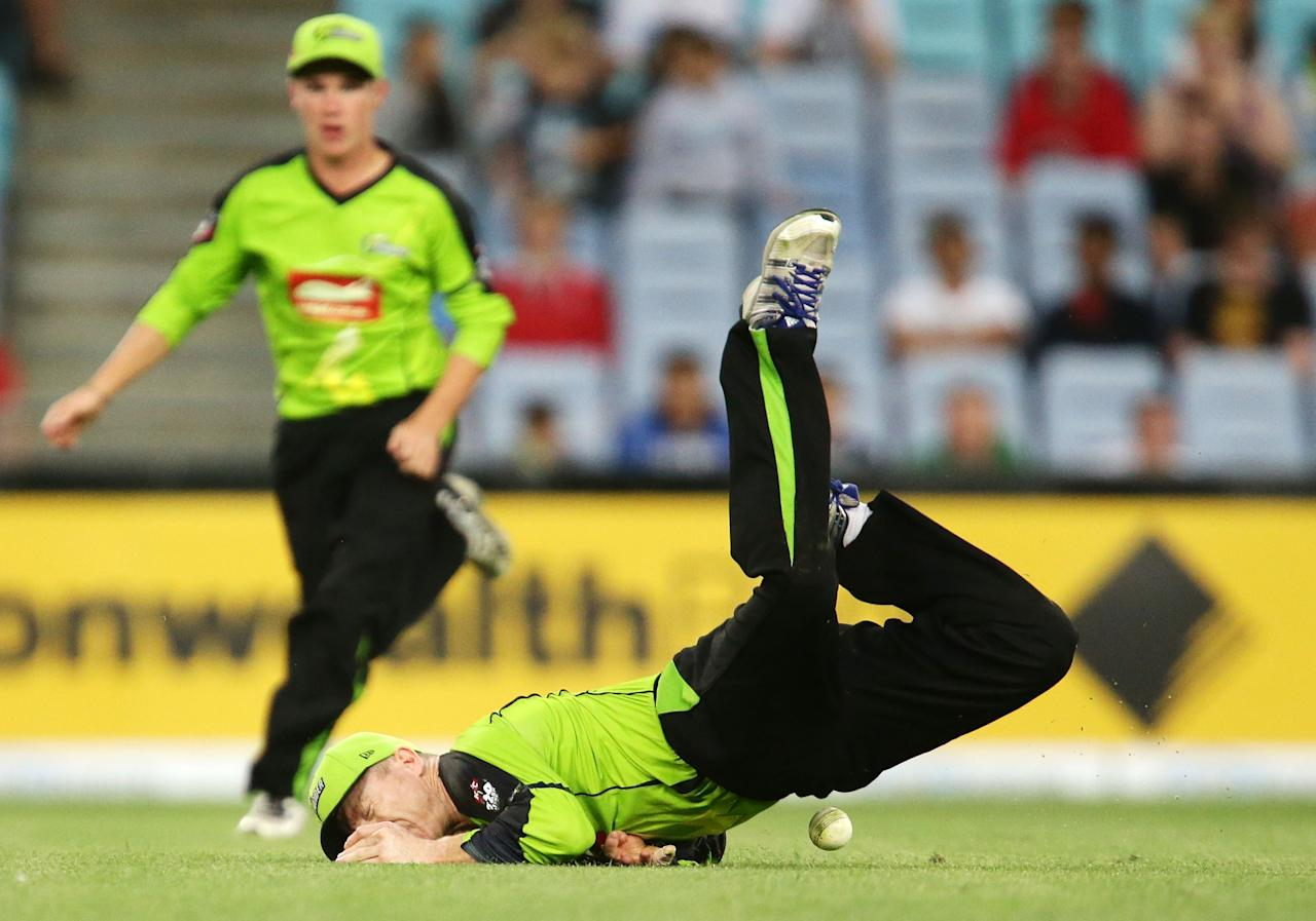 SYDNEY, AUSTRALIA - DECEMBER 20:  Chris Rogers of the Thunder hits the ground after missing a catching chance during the Big Bash League match between the Sydney Thunder and the Adelaide Strikers at ANZ Stadium on December 20, 2012 in Sydney, Australia.  (Photo by Matt King/Getty Images)