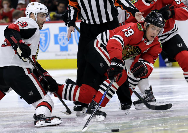 Chicago Blackhawks center Jonathan Toews, right, controls the puck against Ottawa Senators center Derick Brassard during the first period of an NHL hockey game Wednesday, Feb. 21, 2018, in Chicago. (AP Photo/Nam Y. Huh)