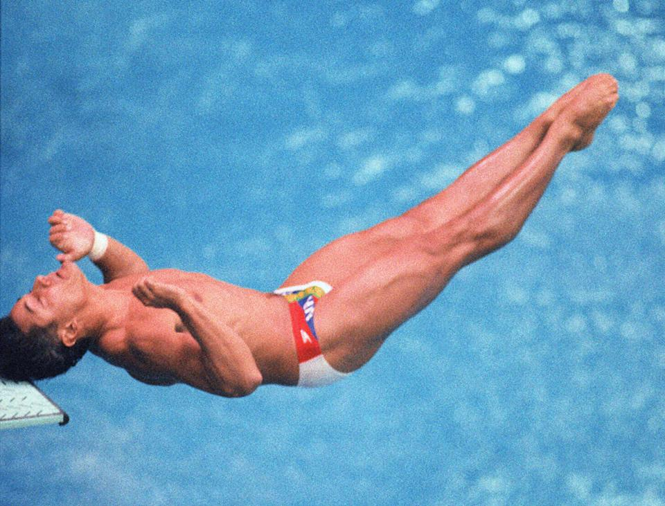 This 11 September 1988 photo shows US diver Greg Louganis hitting the diving board during the 1988 Olympics in Seoul. (PHOTO: AFP)