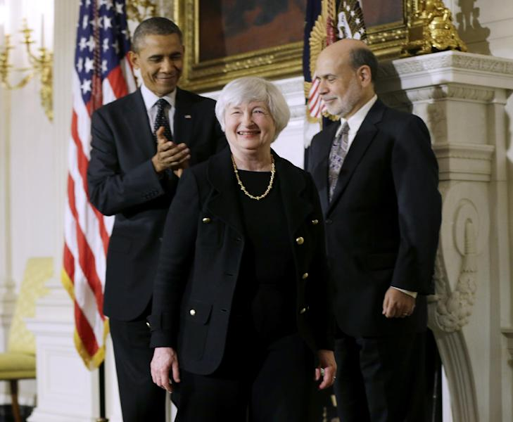 President Barack Obama applauds as he walks out the State Dining Room of the White House in Washington, Wednesday, Oct. 9, 2013, with outgoing Federal Reserve Chairman Ben Bernanke, right, and Janet Yellen, center, his nominee to replace Bernanke. (AP Photo/Pablo Martinez Monsivais)