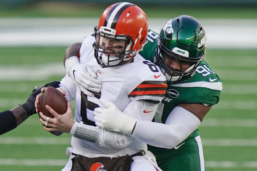 New York Jets defensive end John Franklin-Myers (91) sacks Cleveland Browns quarterback Baker Mayfield (6) during the first half of an NFL football game Sunday, Dec. 27, 2020, in East Rutherford, N.J. (AP Photo/Corey Sipkin)