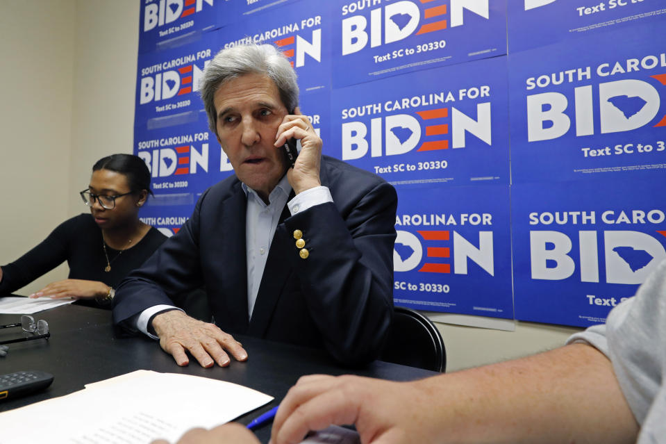 Former Secretary of State John Kerry talks to voters at a phone bank at a campaign office for Democratic presidential candidate and former Vice President Joe Biden, in Rock Hill, S.C., Wednesday, Feb. 19, 2020. (AP Photo/Gerald Herbert)